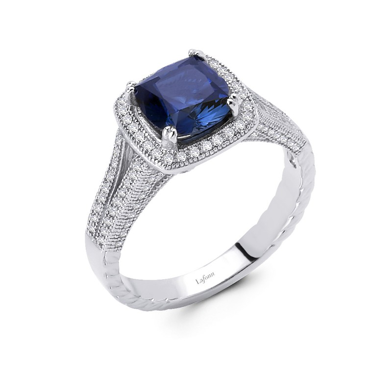 Simulated Diamonds and Sapphire Ring